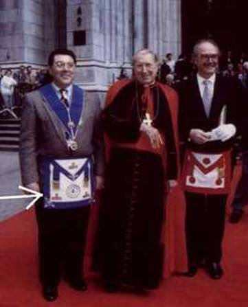 Cardinal John O'Connor, flanked by two freemasons in his New York cathedral. All looks very cosy and ecumenical